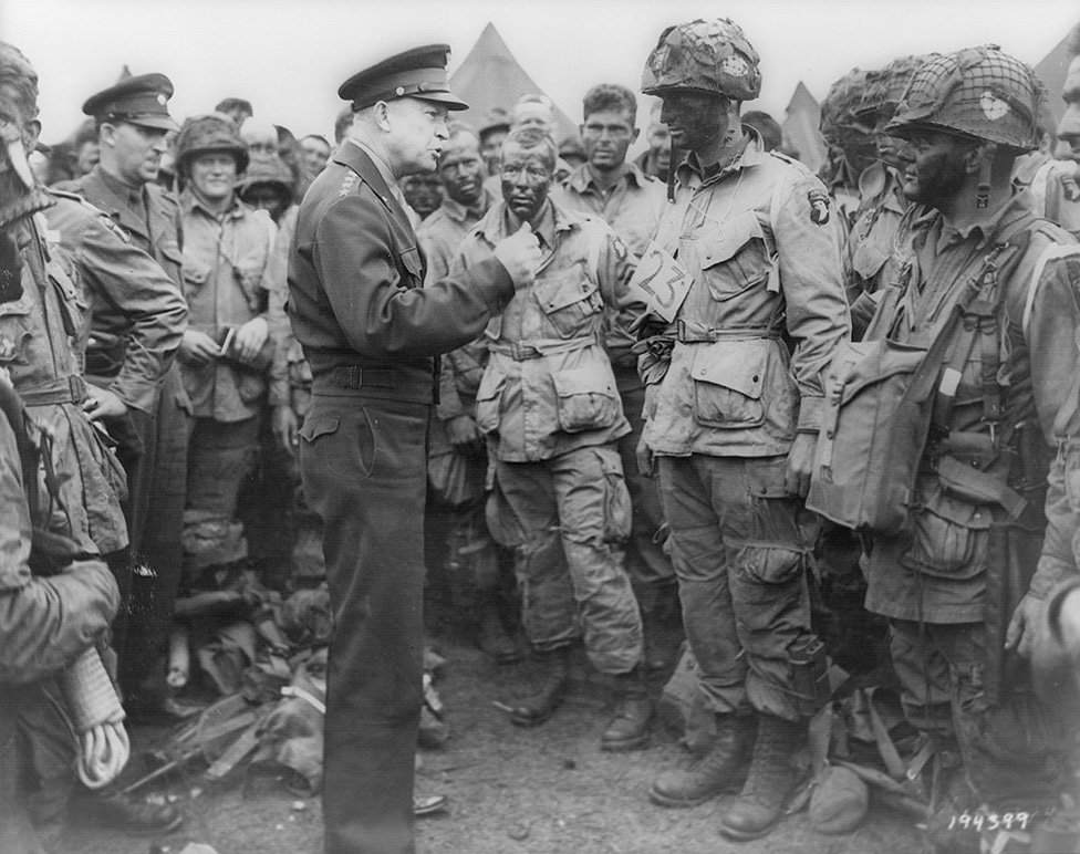 Black and white photo of General Dwight D. Eisenhower addresses American paratroopers prior to D-Day